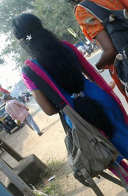 Kerala college girl in loose open hair style tied at bottom.