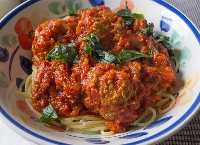 """""""Red Sauce"""" """"Sunday Sauce"""" spaghetti with meatballs italian pasta, a jar of tomato sauce,"""