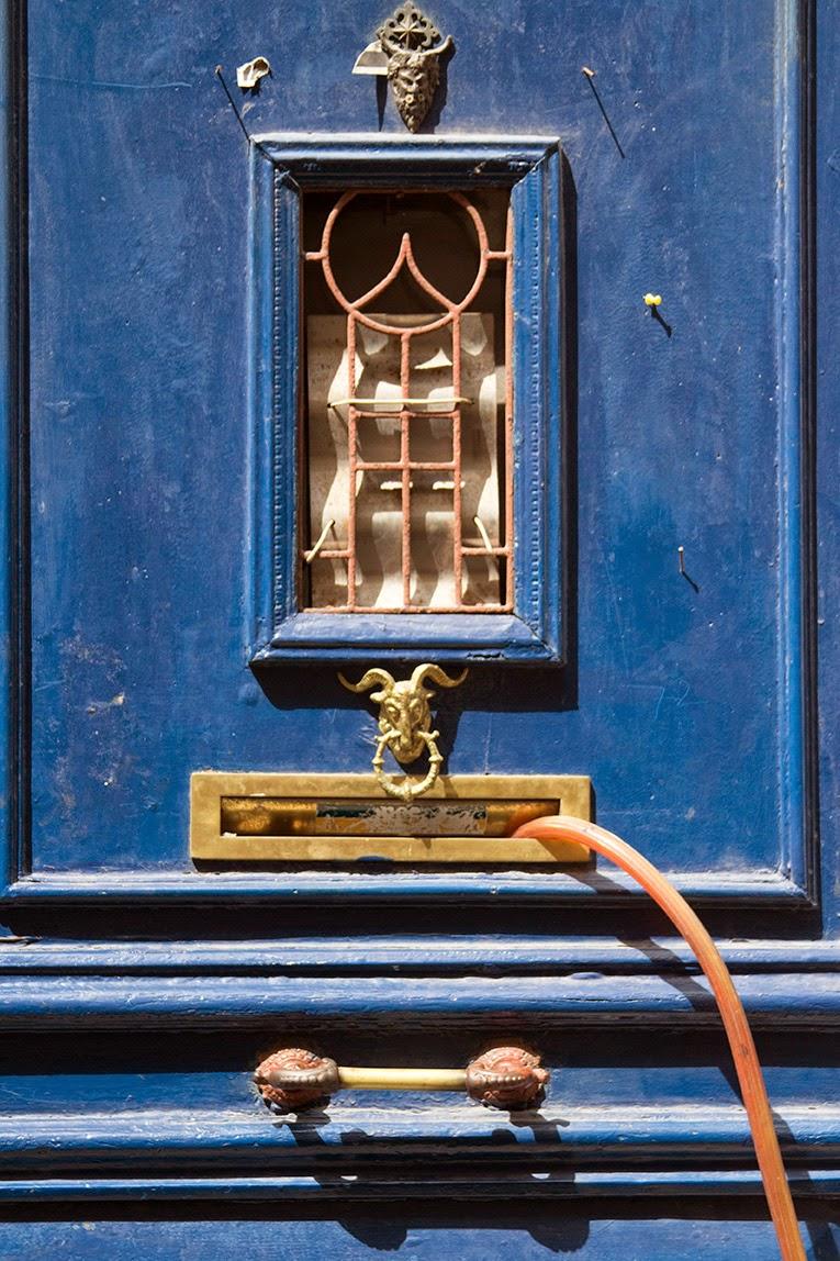blue door with hose