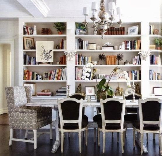 bookcases in dining room dark wood floors