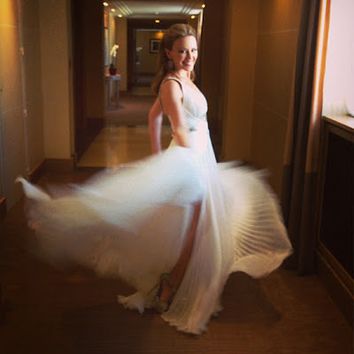 Kylie Minogue in white pleated dress