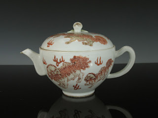 "<img src=""Chinese tea Pot .jpg"" alt=""Foo lions in Iron red Decorations"">"