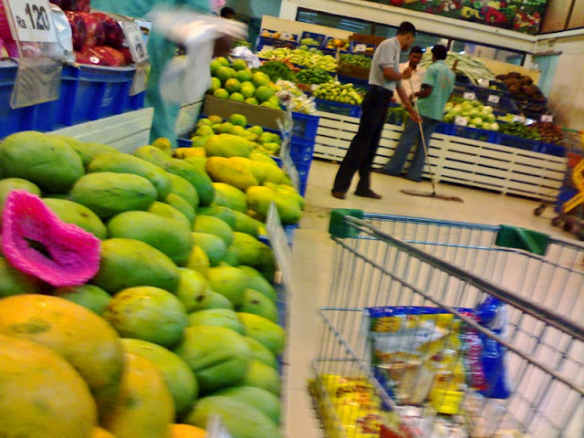 fruits and vegetables being sold in supermarket