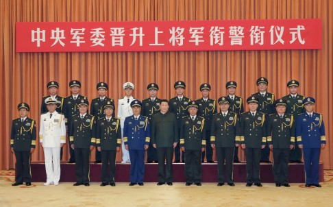 Chinese President Xi Jinping with the ten newly promoted generals at Friday's ceremony, a day after the announcement of former army chief Gen. Guo Boxiong to face prosecution for graft allegation. Photo: Xinhua