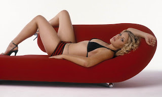 Hot Busy Phillips reclining with her long sexy legs