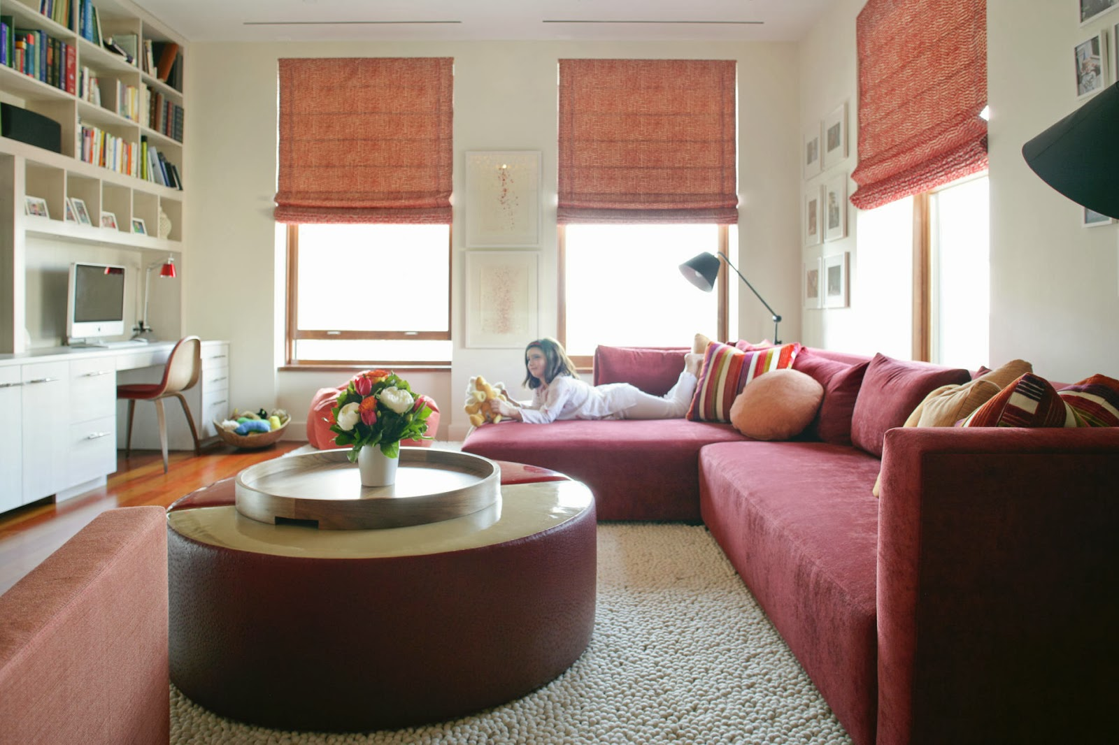 ample family room with vibrant pops of color and large sectional sofa