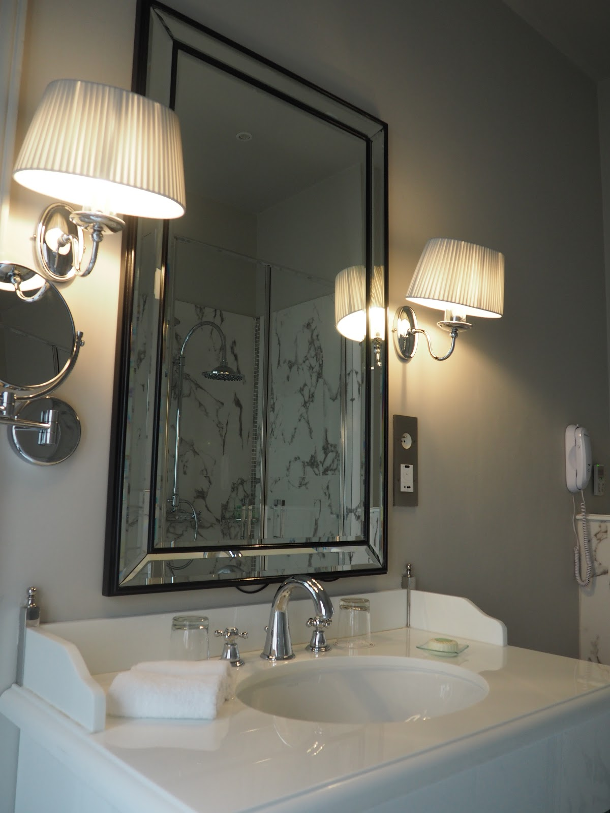 white marble bathroom in Saint-Honore-Suite, Hotel Westminster, Paris
