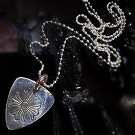 Chrome Hearts Guitar Pick Pendant in sterling silver.