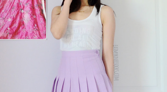 A cute, pastel-toned outfit with the white Snapmade custom-print tank top and an AA dupe lilac pleated tennis skirt.