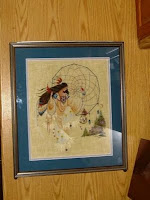 counted cross-stitch picture of Native woman dancing with dream catcher
