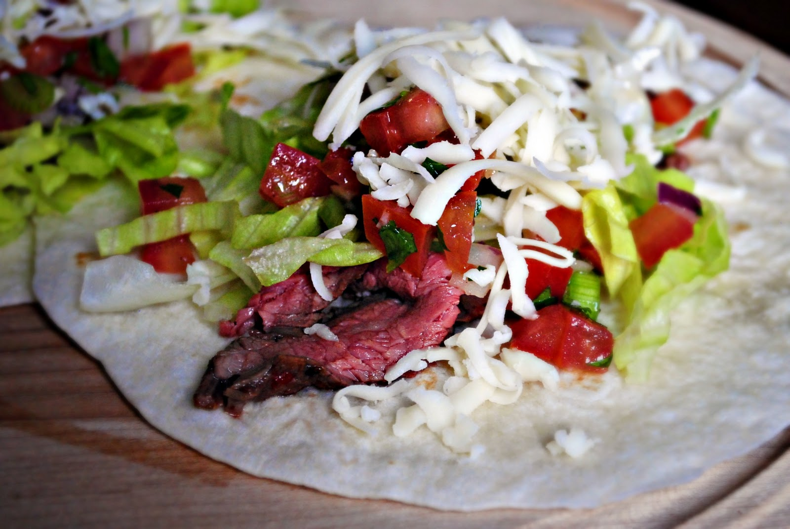 Top the steak with the lettuce, pico and freshly shredded Monterey ...