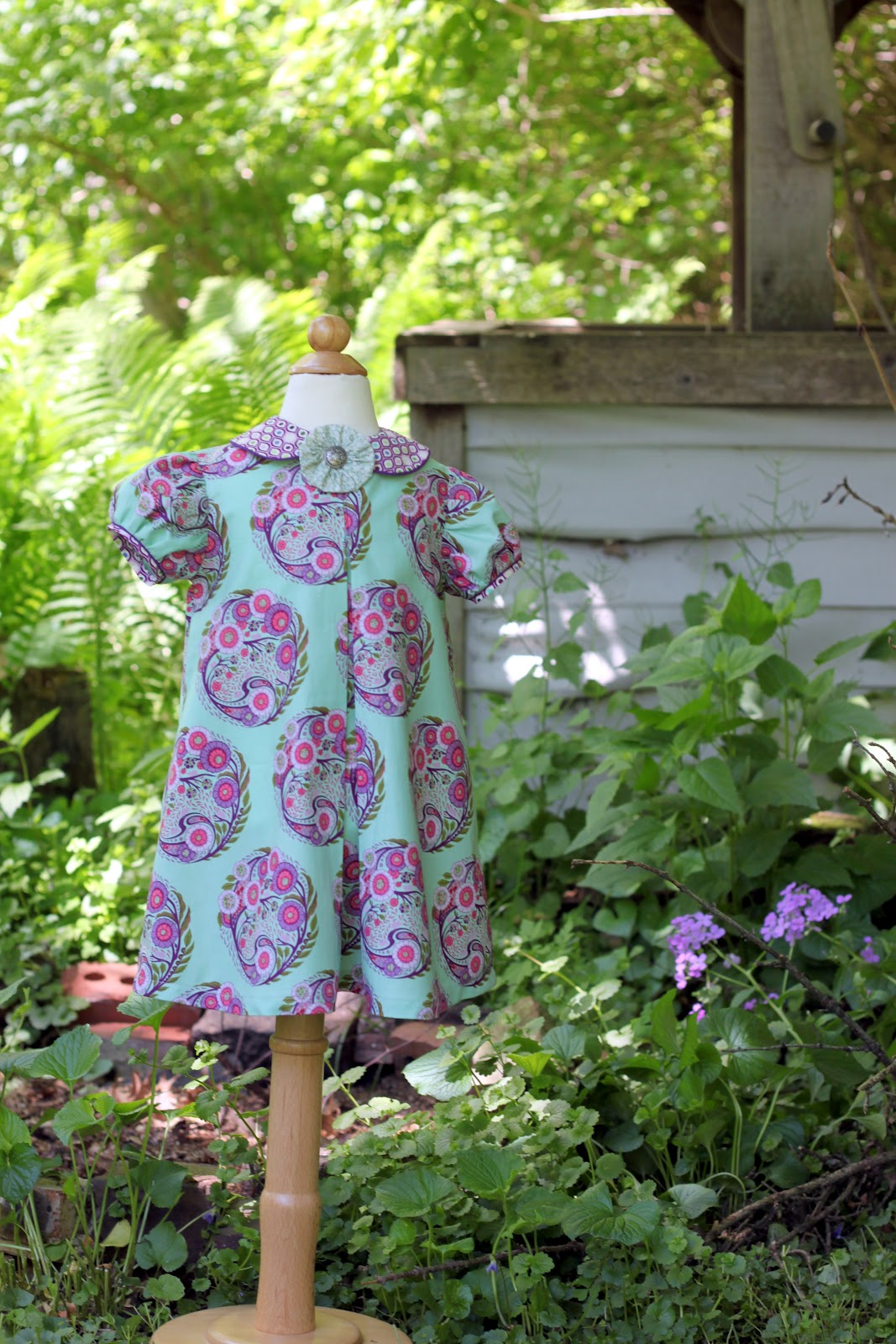 So i leave you with some pictures of this sweet classic vintage may dress that were taken out by the well in front of our house the well no longer works
