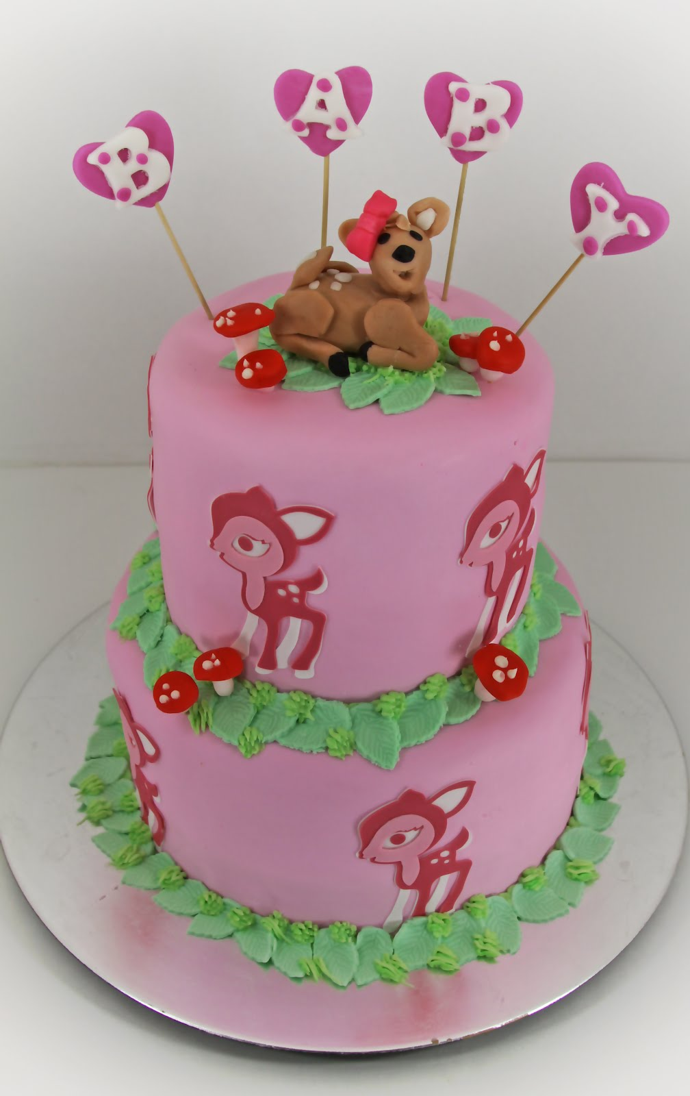 tastefully done woodland animal bambi baby shower cake