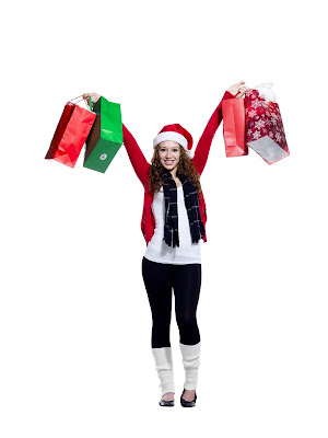 young woman in Santa hat with shopping bags