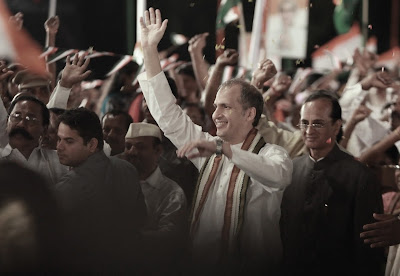 Rajiv Gandhi lookalike waves to the crowd during a rally in Madras (now Chennai), Madras Cafe, Directed by Shoojit Sircar