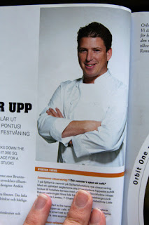 Male chef in normal 'chef pose' with chef clothes on