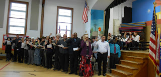 New U.S. citizens take the Oath of Allegiance during their naturalization ceremony.