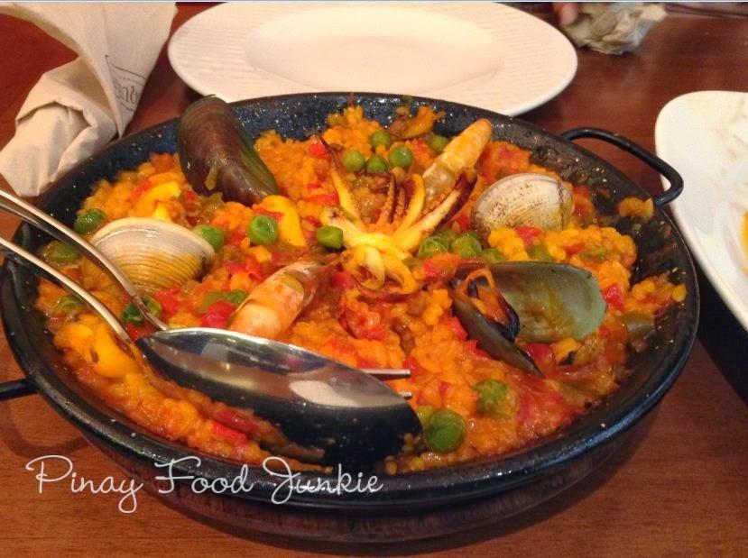 Scooping rice in Boqueria Paella Marinera