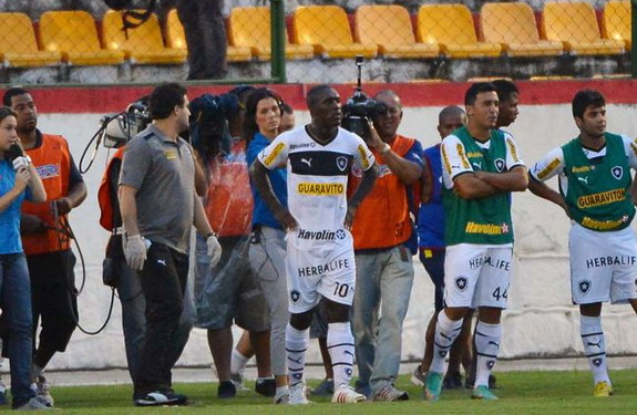 Botafogo player Clarence Seedorf reacts after being sent off during a game against Madureira