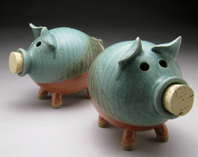 two piggy banks with cork noses