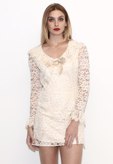 Vintage 1960's white lace mini dolly dress with ruffled cuffs and bow at the neckline.