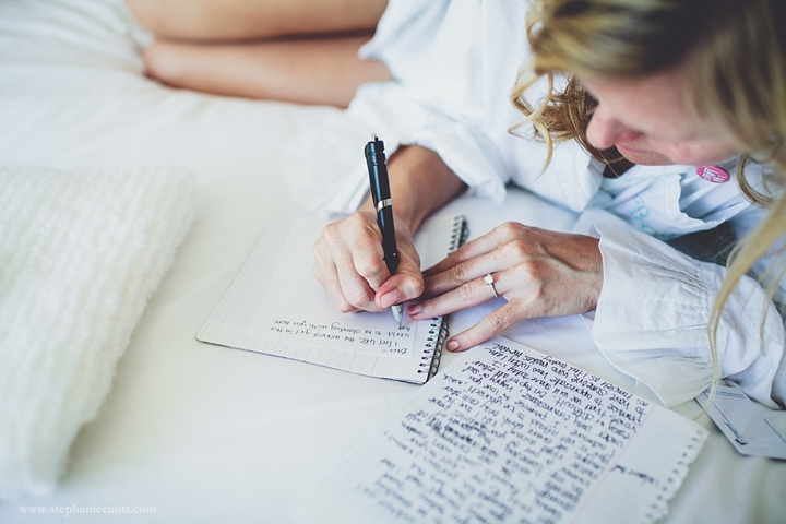 """bride writing vows for wedding ceremony"""