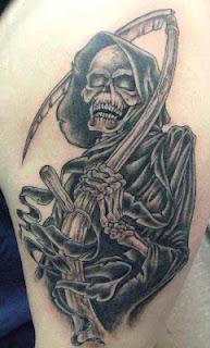 Black and white Grim Reaper tattoo