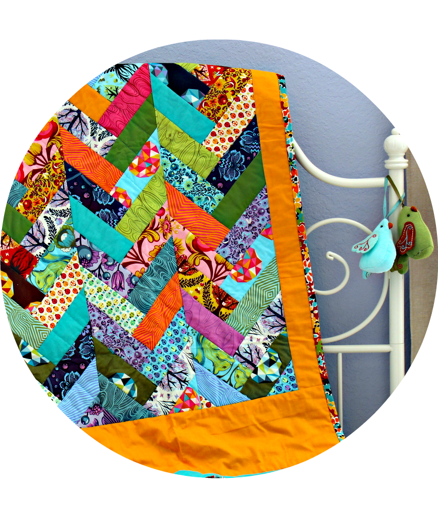folded Because I'm Me girls zig zag quilt in bright colors, with pink, green, blue, purple cotton