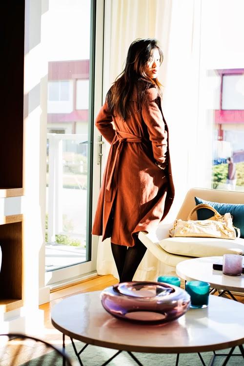Vancouver Fashion blogger Jasmine Zhu wearing ruffle shirt, leather shorts and textured tights, obakki cashmere full length coat