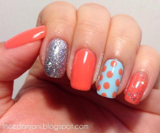 Polka dots, peach, blue, and silver glitter nails