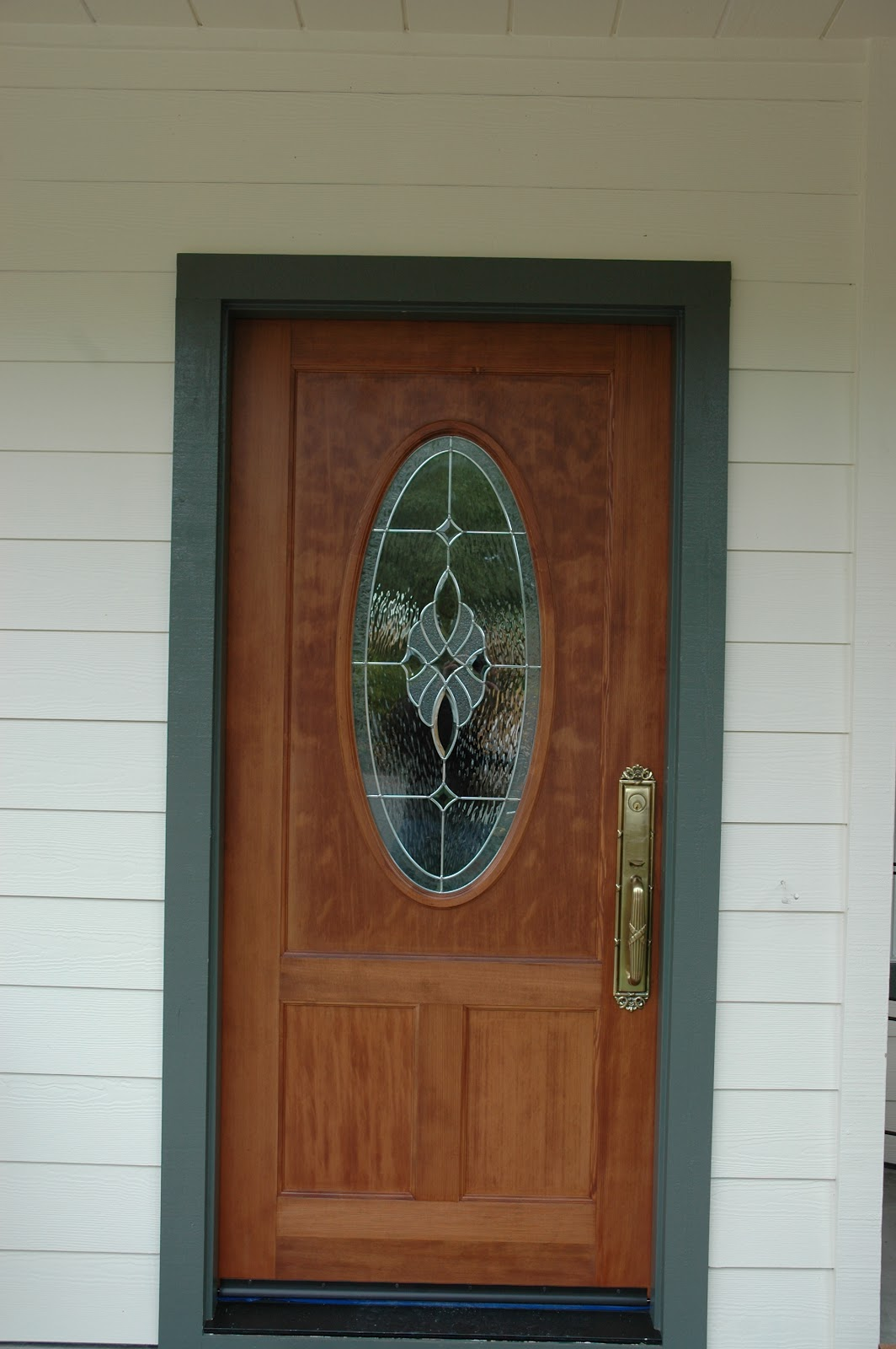 Charming Wood Exterior Front Entry Door With Baldwin Brass Hardware And Lead Glass Oval  Window