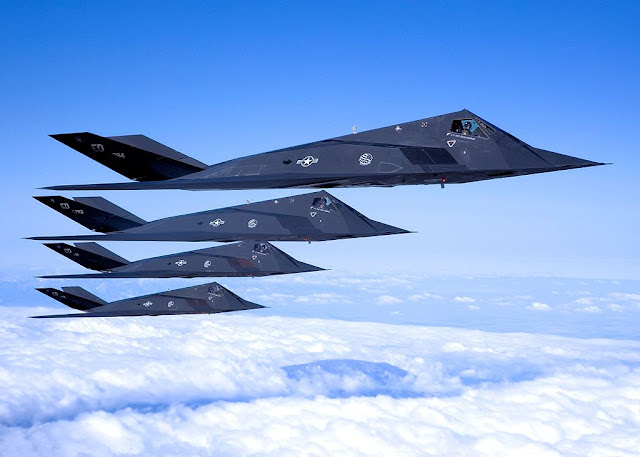 four F-117 Nighthawk formation