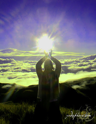 Mountaineer catching the sunrise at Mt. Pulag summit