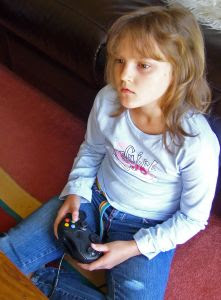 child playing a videogame