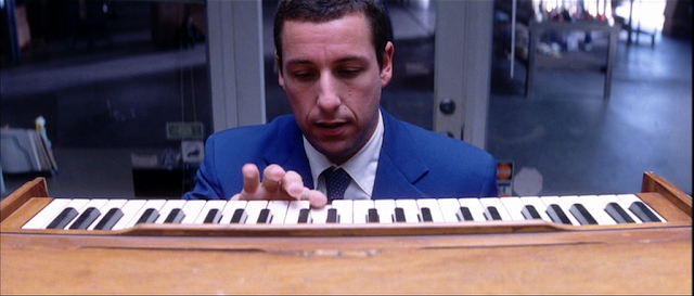 Adam Sandler playing on harmonium in Punch-Drunk Love