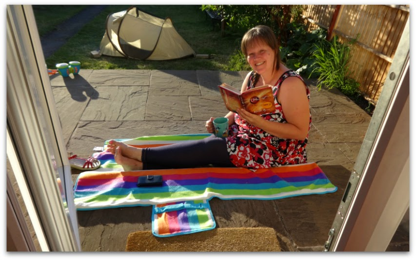 Mum relaxing in the sun after a long day. Reading the Secret.