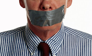 man with tape over his mouth