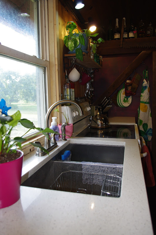 Note the laminate countertops and lack of cabinets. The only cabi title=