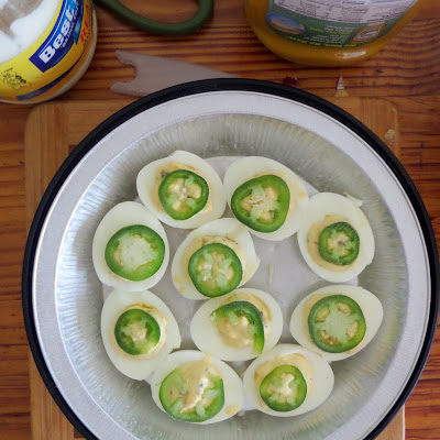 Jalapeno Deviled Eggs:  Hard-boiled eggs, split, and the whites filled with a spicy jalapeno yolk mixture.