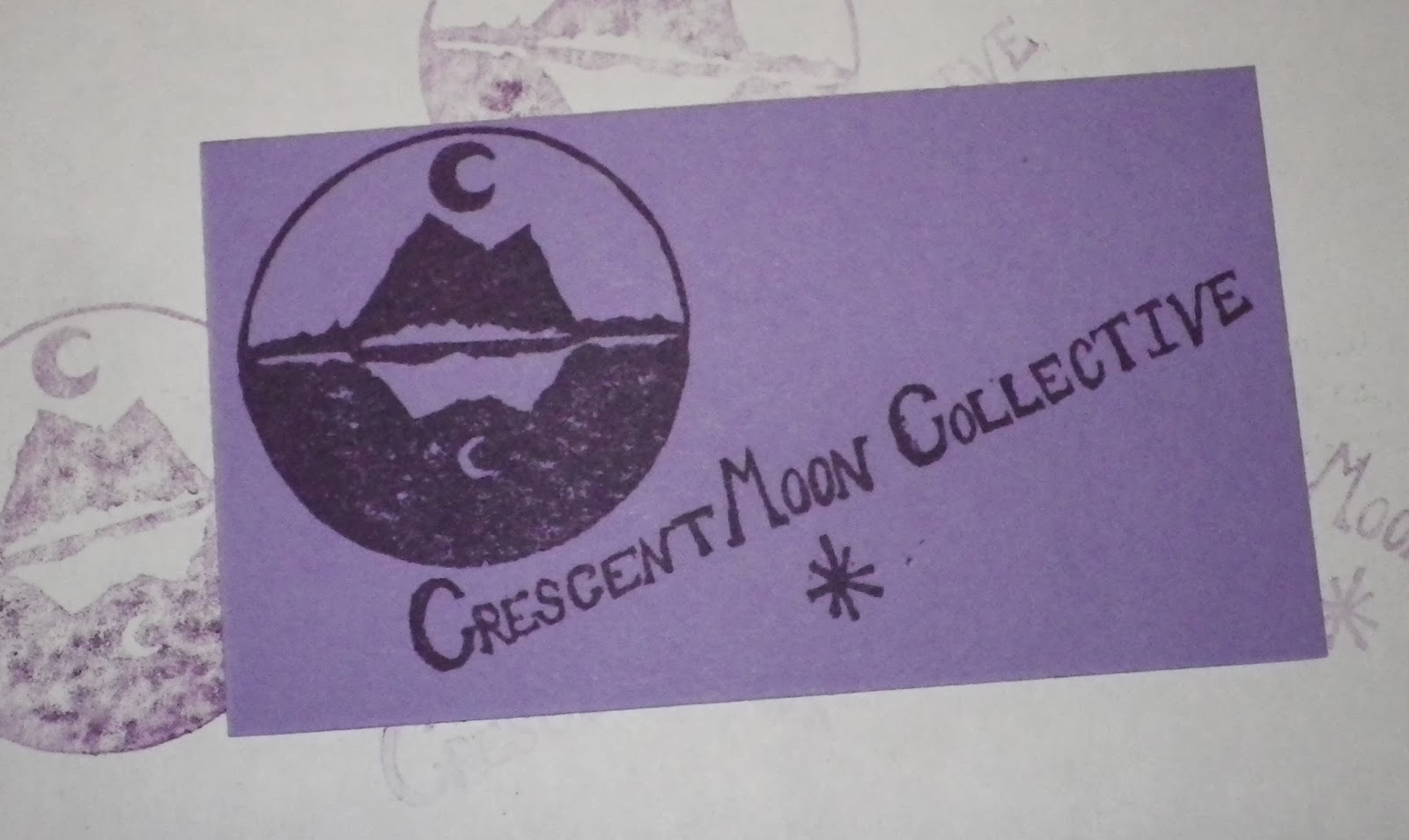 Crescent Moon Collective hand stamped purple business card
