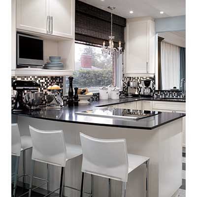 Likethe black counter tops add a lot of warmth, the black/white