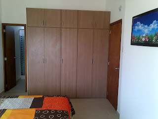 image of integrated wardrobes for second bedroom with entance to room and also door leading to ensuite shower room