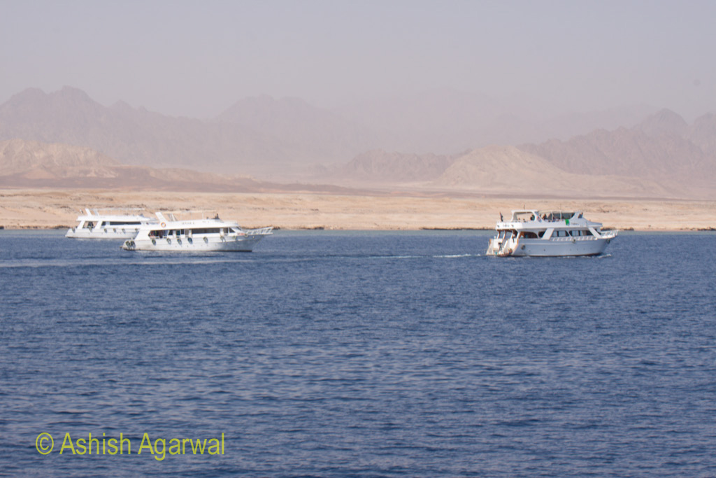 Tourist ships in the Red Sea, very close to the shore near Sharm el Sheikh