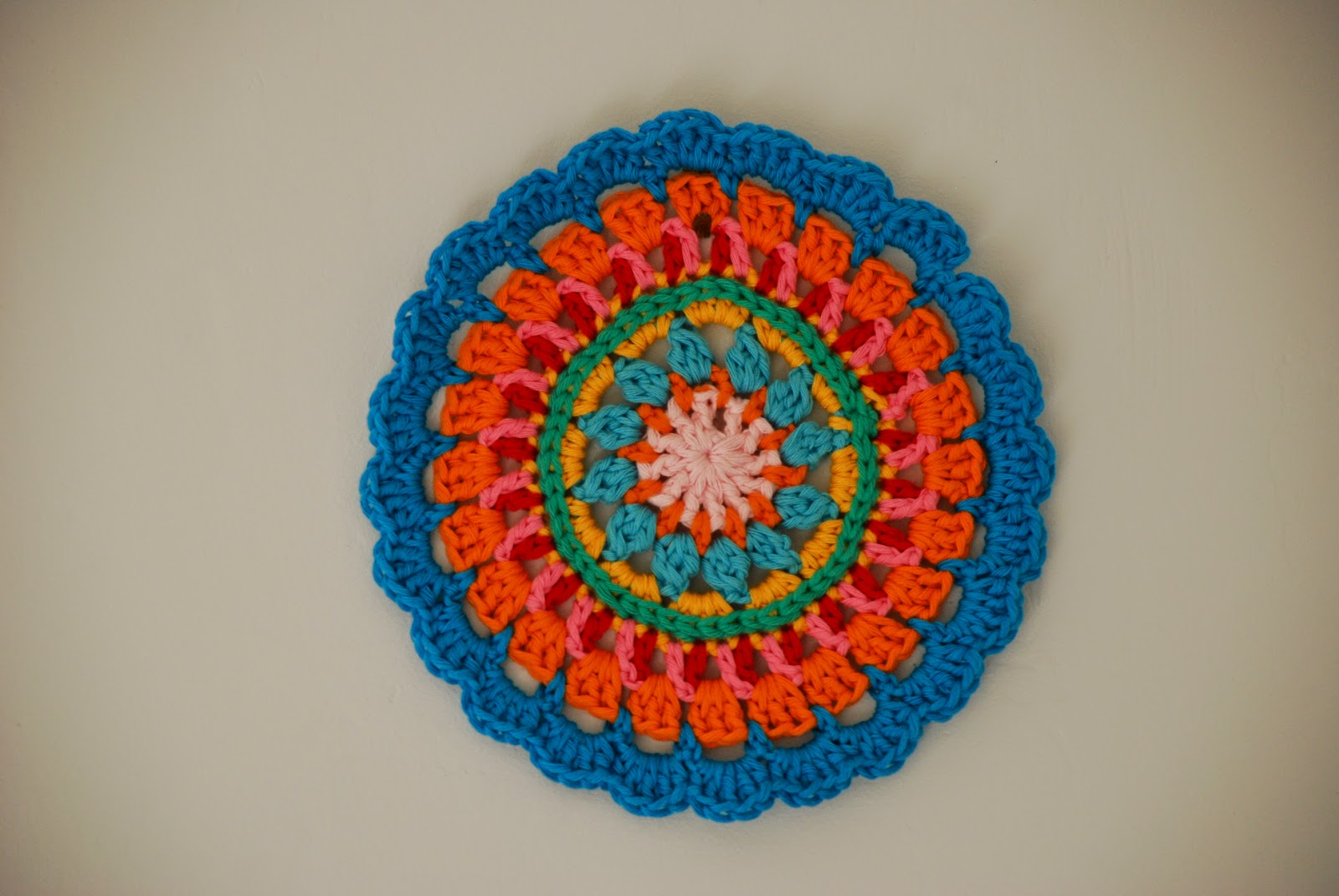 image of crochet mandala using rainbow colours