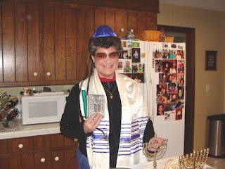 Laurel with items of Jewish worship and prayer