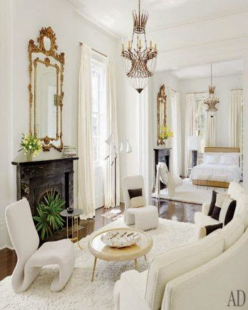 super mix of styles in white living room gold chandelier and accents architectural digest