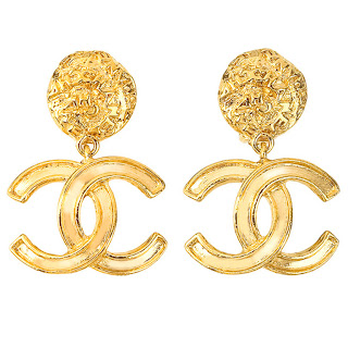 "Vintage 1990's gold dangling Chanel earrings with large ""CC"" logo."