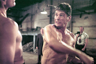 Chaney swinging at an opponent Hard Times 1975 movieloversreviews.blogspot.com