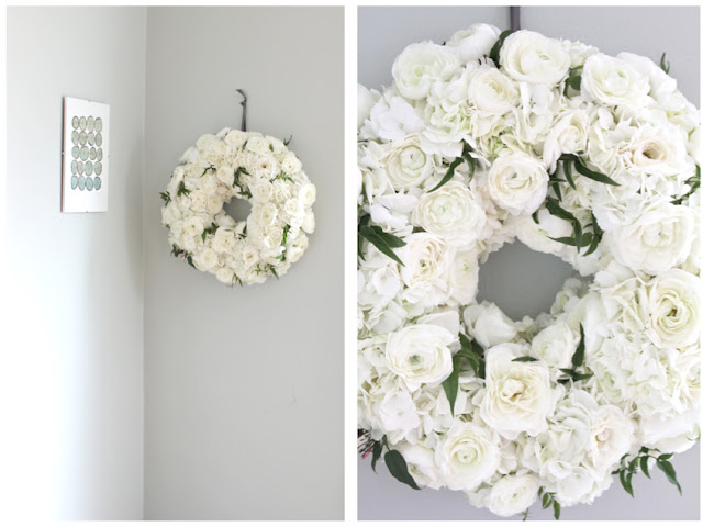 bright white fresh floral wreath by Sweet Pea Floral Design white ranunculus and hydrangea with jasmine vine wedding decor accent