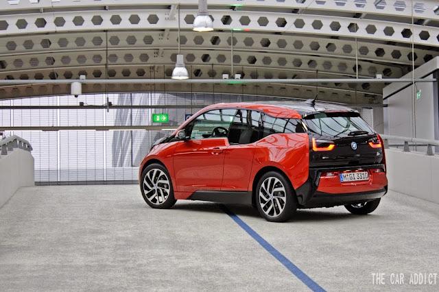 orange BMW i3 at the Airport in Schipol